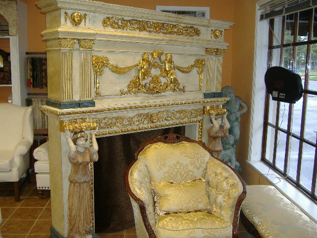 Fireplace Mantel With Carved Wood And Gold Trim